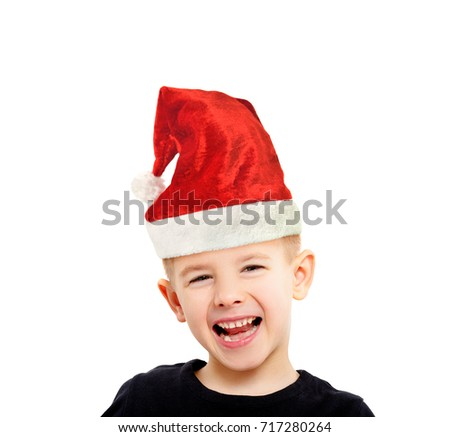 Portrait of attractive laughing boy in a New Year's cap, isolated on white background