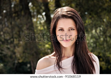 Portrait of attractive long hair young brunette woman - stock photo