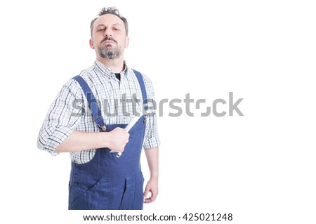 Portrait of attractive male mechanic in blue overalls holding wrench acting like a boos with copyspace isolated on white - stock photo