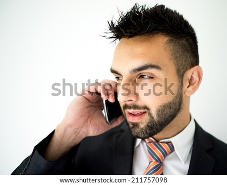 Portrait of attractive man calling on cell phone - stock photo