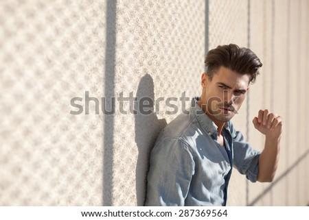 portrait of attractive man dressed casual, looking cool and very appealing - stock photo