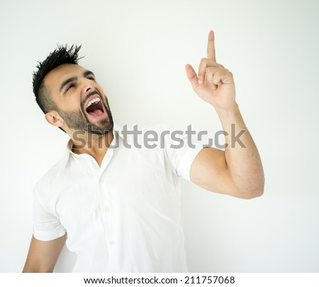 Portrait of attractive man yelling with finger up - stock photo