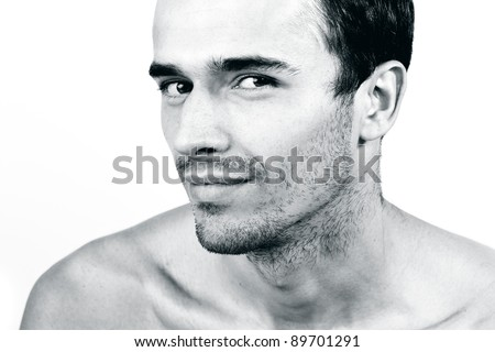 Portrait of attractive man, young handsome male model- made in studio on white background, black and white version