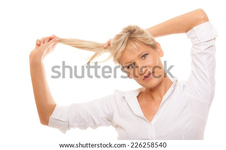 Portrait of attractive mature woman blonde holding her long healthy hair isolated on white background