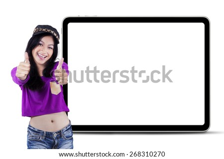 Portrait of attractive modern teenage girl showing thumbs up with an empty board on the back - stock photo