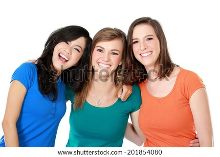 portrait of attractive multi racial three girls best friend together having fun isolated over white background
