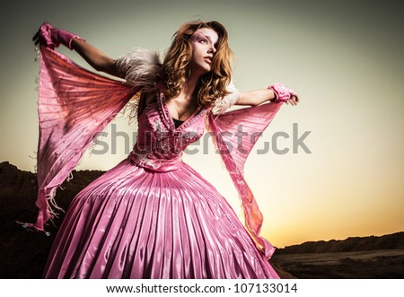 Portrait of attractive romantic woman at fairy dry field.