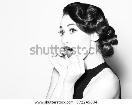 Portrait of attractive sensual glamour retro elegant young adult surprised woman with classic hairstyle and red lips in evening dress indoor black and white, horizontal picture - stock photo