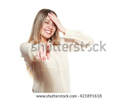 portrait of attractive smile laugh teenage girl, pointing her finger, wear beige shirt, white teeth, blond long hair, isolated over white background concept of student point at you, young pretty woman - stock photo