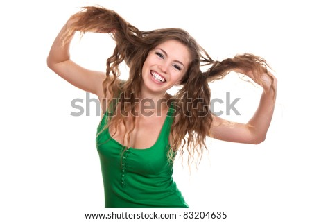 portrait of attractive smile teenage girl, hold her hair by hands wear green shirt, with white teeth, brown long hair, isolated over white background concept of happy student, young pretty woman - stock photo