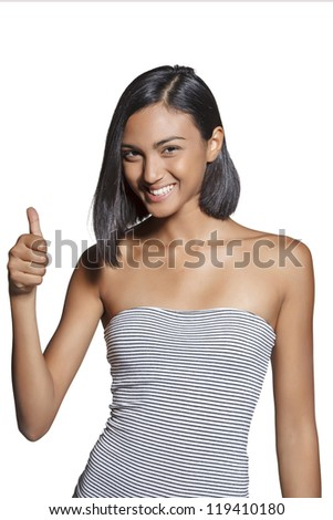 portrait of attractive smile teenage girl show thumbs up gesture, brown eyes and hair, concept of success happy student, young pretty woman. On white background - stock photo