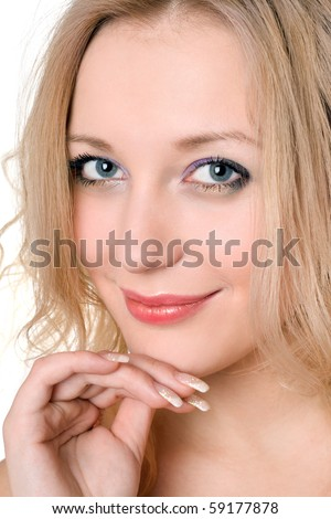 Portrait of attractive smiling blond woman. Isolated on white