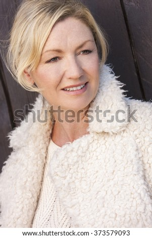 Portrait of attractive smiling middle aged woman with perfect teeth