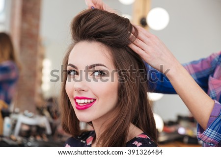Portrait of attractive smiling young woman in beauty salon - stock photo