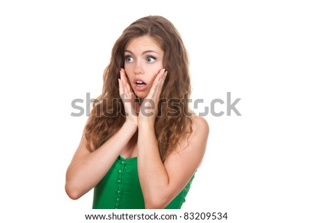 portrait of attractive surprised excited scared, terrified teenage girl wear green shirt, with brown long hair, isolated over white background concept of worried student, young pretty woman - stock photo