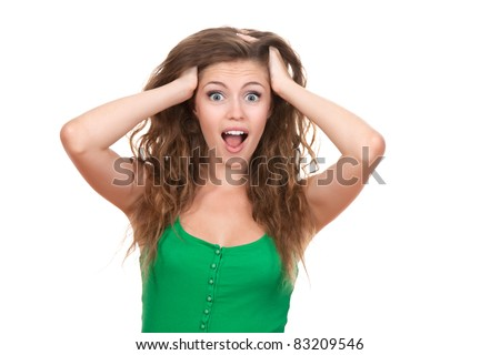 portrait of attractive surprised excited smile teenage girl hold hands on head, green shirt, white teeth, brown long hair, isolated over white background concept of happy student, young pretty woman - stock photo