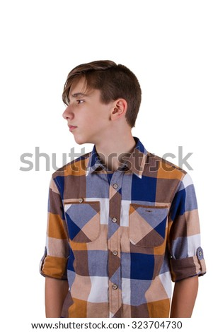 Portrait of attractive teen boy being photographed in a studio. Isolated on white background - stock photo