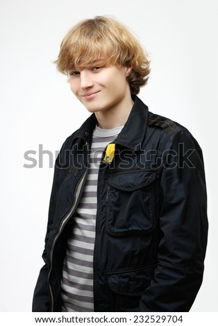 Portrait of attractive teenage boy  smiling at the camera. - stock photo