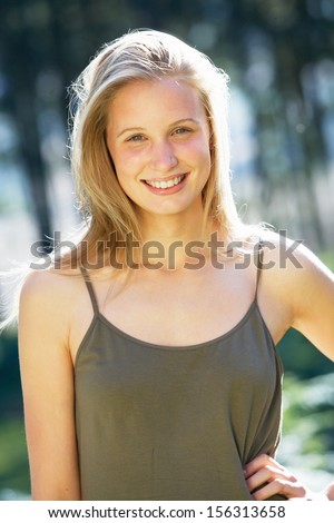 Portrait Of Attractive Teenage Girl In Countryside - stock photo