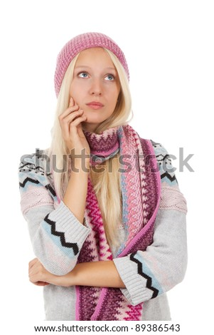 portrait of attractive teenage girl sad think looking up,  wear winter knitted pink hat scarf and sweater, isolated over white background concept of pondering thoughtful student, young pretty woman - stock photo