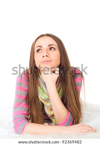 portrait of attractive teenage girl think looking up - stock photo