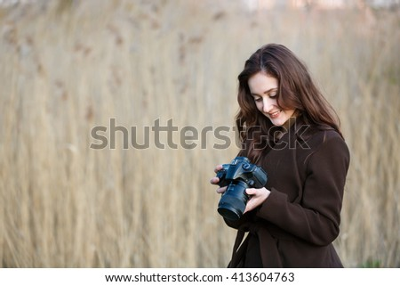 Portrait of attractive teenage girl with camera