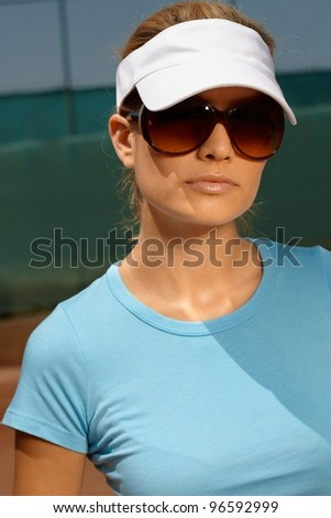Portrait of attractive woman at summer in tennis outfit and sunglasses.? - stock photo