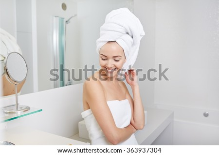 Portrait of attractive woman in bathroom - stock photo