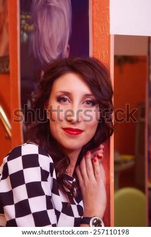 portrait of attractive woman. indoor shot - stock photo