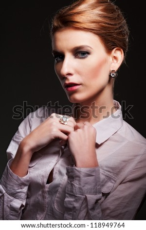 portrait of attractive woman over black background