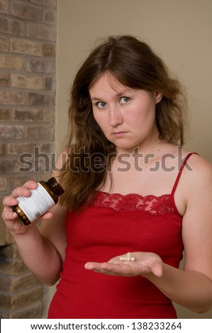 portrait of attractive woman with pills - stock photo