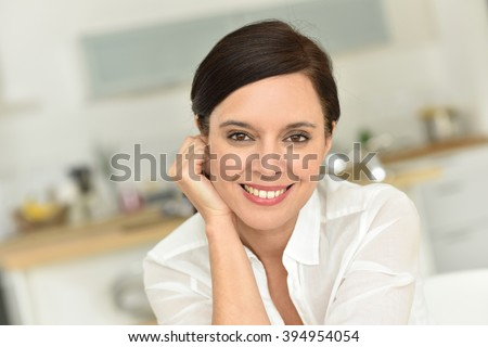 Portrait of attractive 40-year-old woman at home - stock photo