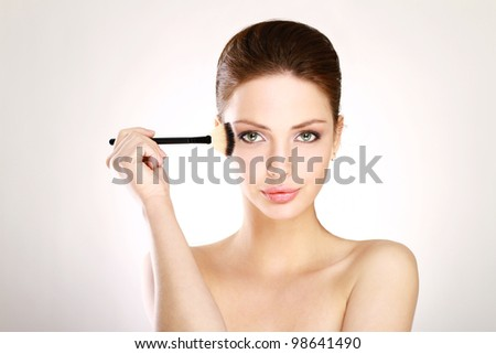 Portrait of attractive young adult woman - stock photo