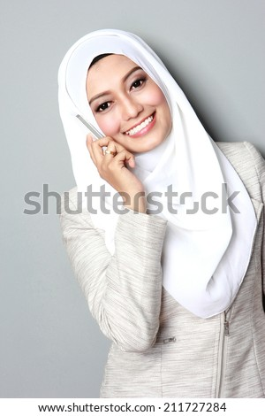 portrait of attractive young asian woman calling using mobile phone - stock photo