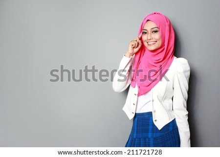 portrait of attractive young asian woman using mobile phone - stock photo