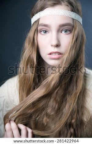 Portrait of attractive young blonde woman with long hair - stock photo