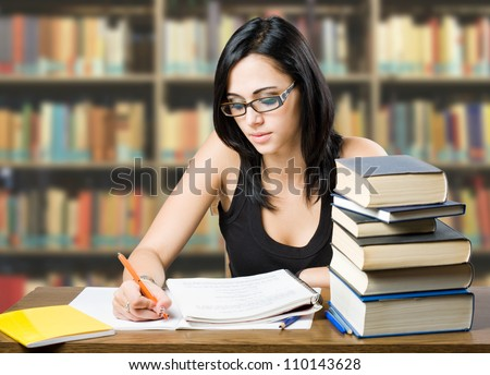 Portrait of attractive young brunette student girl. - stock photo