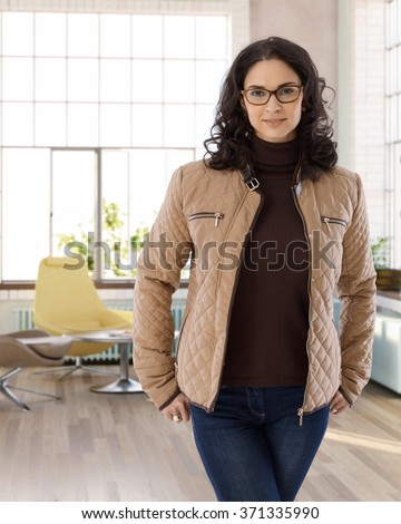Portrait of attractive young businesswoman standing at home. - stock photo