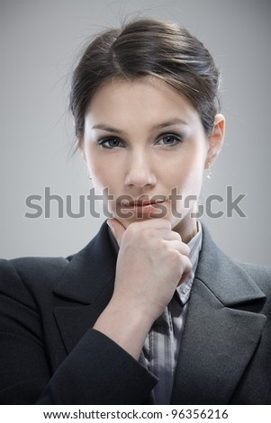 Portrait of attractive young businesswoman thinking.? - stock photo