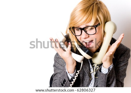 portrait of attractive young businesswoman with three phones on white background - stock photo