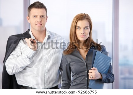 Portrait of attractive young casual businesspeople smiling.? - stock photo