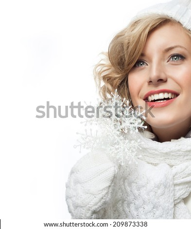 portrait of attractive young caucasian woman  toothy smile  face skin care in warm clothing  studio  shot isolated on white smiling winter snowflake - stock photo