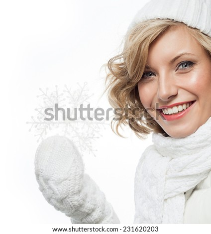 portrait of attractive young caucasian woman  toothy smile  face skin care in warm clothing  studio  shot isolated on white smiling winter snowflake
