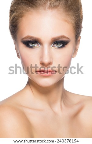 Portrait of attractive young caucasian woman with stylish bright makeup smoky eyes