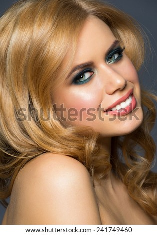 Portrait of attractive young caucasian woman with stylish makeup and hairstyle