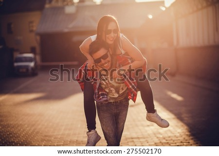 Portrait of attractive young couple in love outdoors. sunset - stock photo