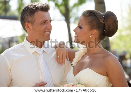 Portrait of attractive young couple on wedding-day, smiling. - stock photo