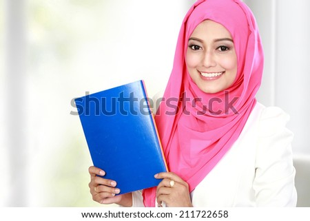 portrait of attractive young female asian student - stock photo