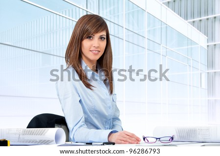 Portrait of Attractive young female office worker at desk.