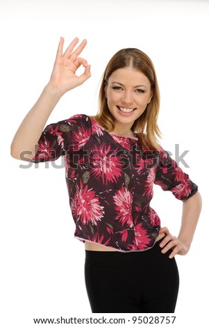Portrait of attractive young female showing a thumbs up on a white background - stock photo